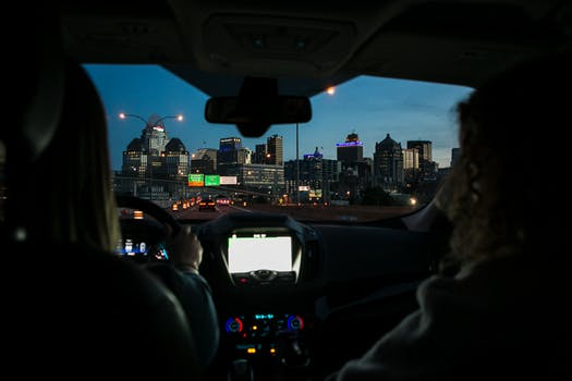 Image from Backseat of Car Used for Intensive Driving Courses with view of cityscape at dusk.